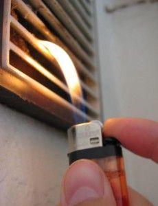 Фото: Проверка тяги вентиляционной системы