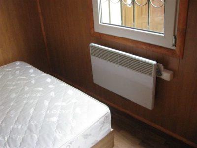 Настенный конвектор в коттеджном домике